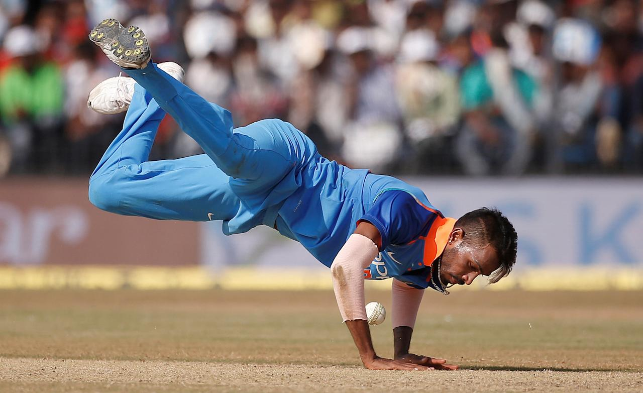 Cricket - India v Australia - Third One Day International Match - Indore, India – September 24, 2017 – India's Hardik Pandya dives to stop the ball. REUTERS/Adnan Abidi     TPX IMAGES OF THE DAY
