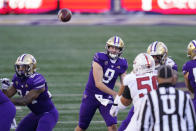 Washington quarterback Dylan Morris (9) throws against Stanford in the first half of an NCAA college football game Saturday, Dec. 5, 2020, in Seattle. (AP Photo/Elaine Thompson)