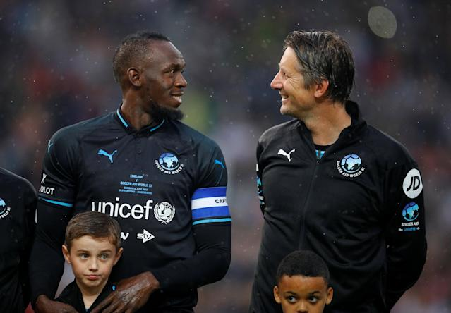 Soccer Football - Soccer Aid 2018 - England v Soccer Aid World XI - Old Trafford, Manchester, Britain - June 10, 2018 World XI's Usain Bolt and Edwin Van Der Sar before the match REUTERS/Phil Noble