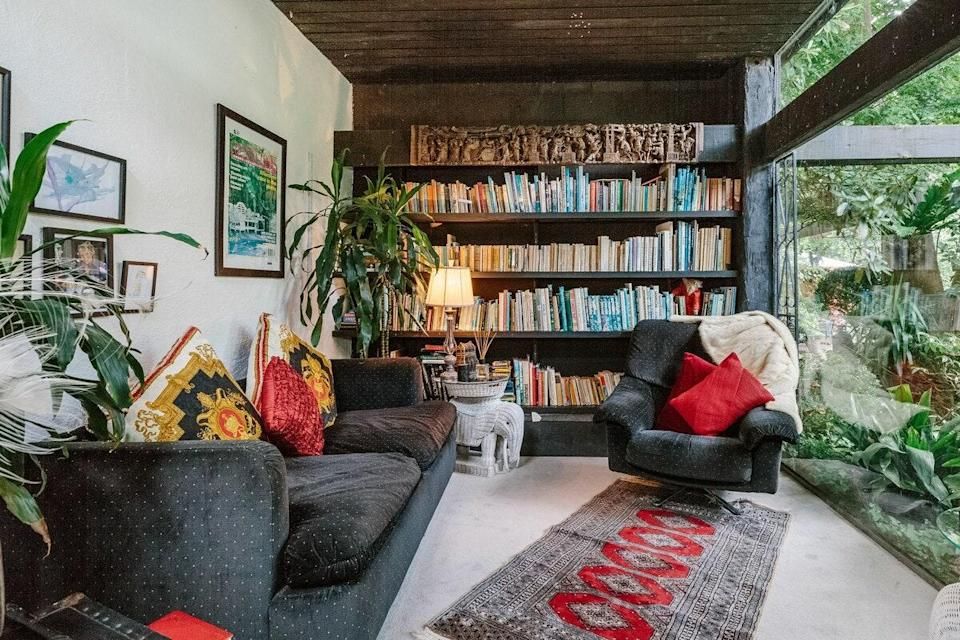"""This eclectically designed one-bedroom villa about an hour outside of Melbourne features a cozy library with floor-to-ceiling views of the lush seven-acre surrounds. There are tons of seating areas throughout the home and garden, so you can really spread out with your book. Bonus: There's a private pool for when you're ready to set your reading aside. $218, Airbnb (Starting Price). <a href=""""https://www.airbnb.com/rooms/2615911/"""" rel=""""nofollow noopener"""" target=""""_blank"""" data-ylk=""""slk:Get it now!"""" class=""""link rapid-noclick-resp"""">Get it now!</a>"""