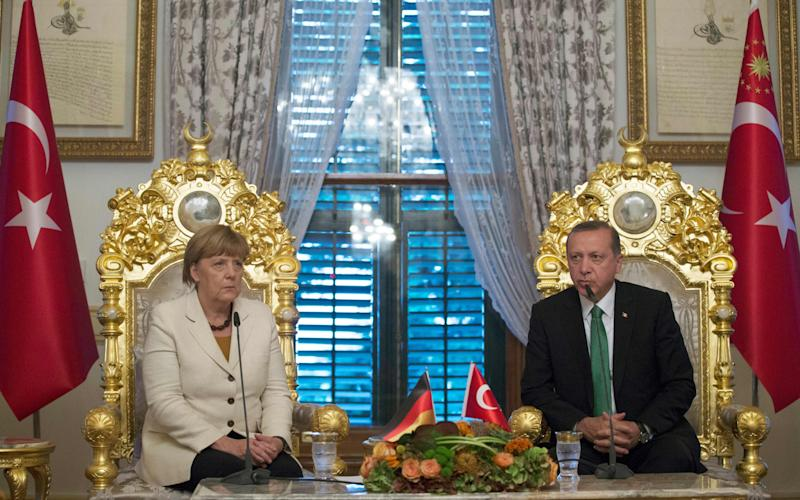 Angela Merkel, the German Chancellor, meets President Recep Tayyip Erdogan in Istanbul in 2015 - Credit: AFP