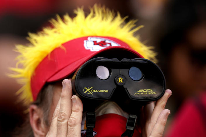 A fan watches during the second half of an NFL football game between the Kansas City Chiefs and the Cleveland Browns Sunday, Sept. 12, 2021, in Kansas City, Mo. (AP Photo/Charlie Riedel)