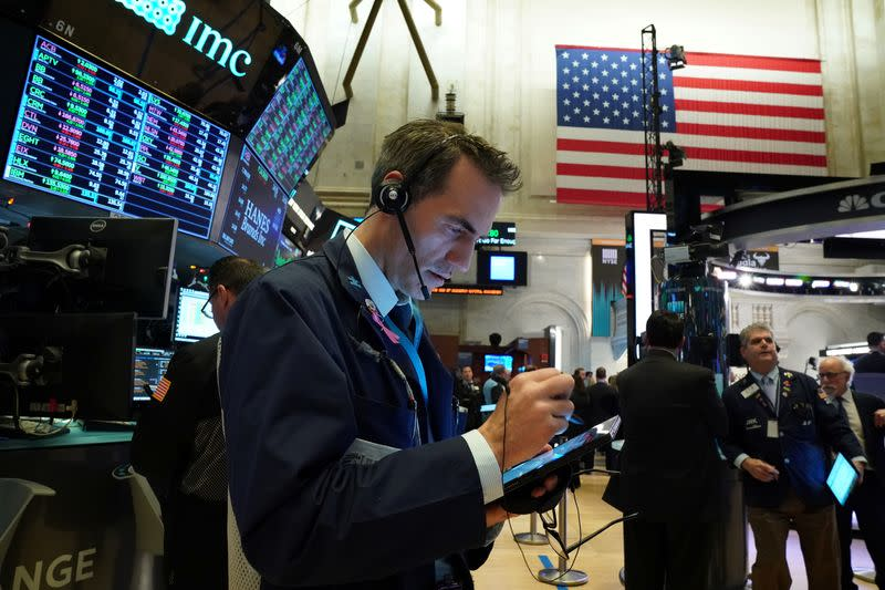 Wall Street dips as investors focus on Middle East, but chipmakers climb