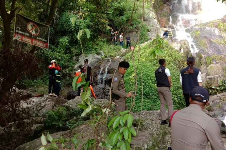 Police are pictured at Na Mueang 2 waterfall after the man fell to his death. Source: AFP