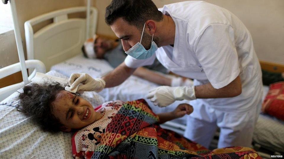 Girl being treated in hospital after being pulled from rubble