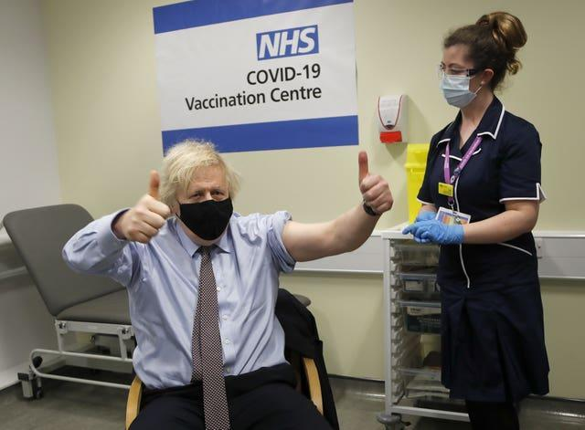 Prime Minister Boris Johnson gives the thumbs up after receiving the first dose of AstraZeneca vaccine (Frank Augstein/PA)
