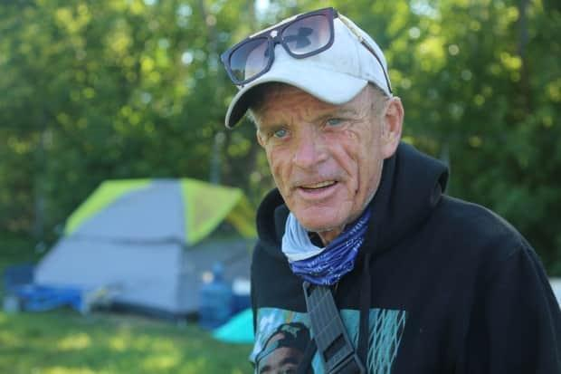 Andrew Fletcher, 60, is living in a Hamilton encampment. He's concerned Ontario's proof of COVID-19 vaccination plan will make life more difficult for people experiencing homelessness. (Dan Taekema/CBC - image credit)