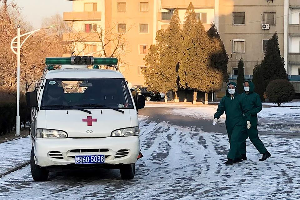 PYONGYANG, NORTH KOREA - FEBRUARY 6, 2020: Doctors in medical masks and protective suits by an ambulance vehicle at the Munsu-dong diplomatic compound amid an outbreak of the 2019-nCoV coronavirus. The Chinese authorities registered an outbreak of the 2019-nCoV coronavirus in Wuhan in December 2019; as of February 6, 2020, the number of people infected with the new strain of coronavirus has risen over 28,000, with the death toll is over 500. Yevgeny Agoshkov/TASS (Photo by Yevgeny Agoshkov\TASS via Getty Images)