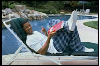 <p>The <em>Fresh Prince of Bel Air </em>himself Will Smith lounging in his backyard in 1996 with a CAA (Creative Artists Agency) folder in hand. </p>
