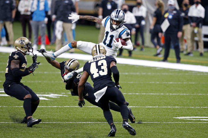 Carolina Panthers wide receiver Robby Anderson (11) is upended on a pass reception by New Orleans Saints cornerback Marshon Lattimore (23), free safety Marcus Williams (43) and safety Chauncey Gardner-Johnson in the first half of an NFL football game in New Orleans, Sunday, Oct. 25, 2020. (AP Photo/Butch Dill)