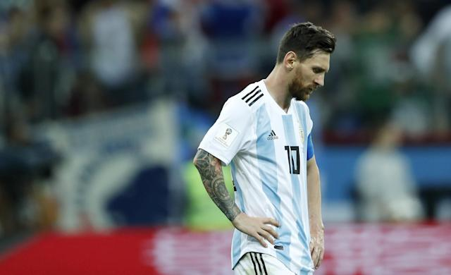 Despondent: Lionel Messi stands dejected as his Argentina side sit on the brink of World Cup elimination. (Getty)