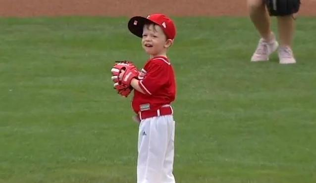 Nolan, a young Reds fan with spunk and determination, readies for his first pitch at Great American Ballpark. (MLB.TV)