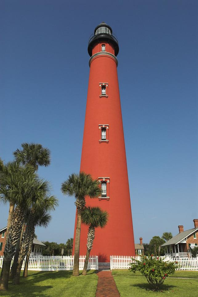 "<p>This gorgeous red lighthouse is the tallest in Florida, and one of the tallest in the United States. <a rel=""nofollow"" href=""http://ponceinlet.org/index.cfm"">Its history</a> goes way back to 1835, though it was out of use for decades because of destruction and construction. It's been back in business since 1982, though, and was named a <a rel=""nofollow"" href=""https://www.countryliving.com/uk/wildlife/countryside/g20880847/worlds-most-popular-landmarks/"">National Historic Landmark</a> in 1998.</p>"