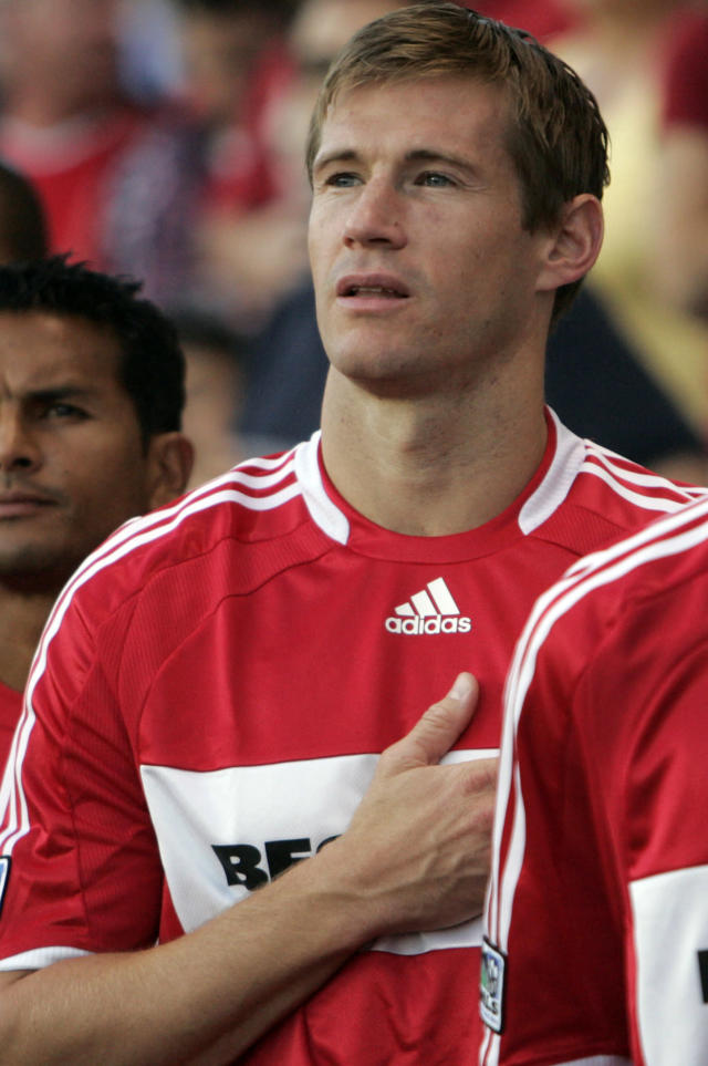 Chicago Fire's Brian McBride listens to the national anthem before the soccer match with D.C. United starts on Saturday, Aug. 16, 2008, in Bridgeview, Ill. (AP Photo/Nam Y. Huh)