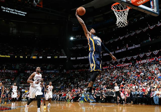 ATLANTA, GA - APRIL 24: Paul George #24 of the Indiana Pacers dunks against the Atlanta Hawks in Game 3 of the Eastern Conference Quarterfinals during the 2014 NBA Playoffs at Philips Arena on April 24, 2014 in Atlanta, Georgia. NOTE TO USER: User expressly acknowledges and agrees that, by downloading and or using this photograph, User is consenting to the terms and conditions of the Getty Images License Agreement. (Photo by Kevin C. Cox/Getty Images)