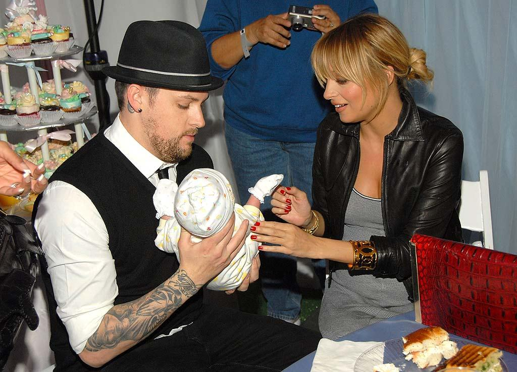 "Joel Madden and Nicole Richie practiced being parents at the launch of the Madden Richie Children's Foundation. The couple hosted a baby shower for 100 moms in need where they reportedly gave away more than $200,000 worth of gifts. Kevin Mazur/<a href=""http://www.wireimage.com"" target=""new"">WireImage.com</a> - December 3, 2007"