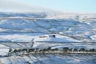 A cottage surrounded by snow in Teesdale. (PA Images via Getty Images)