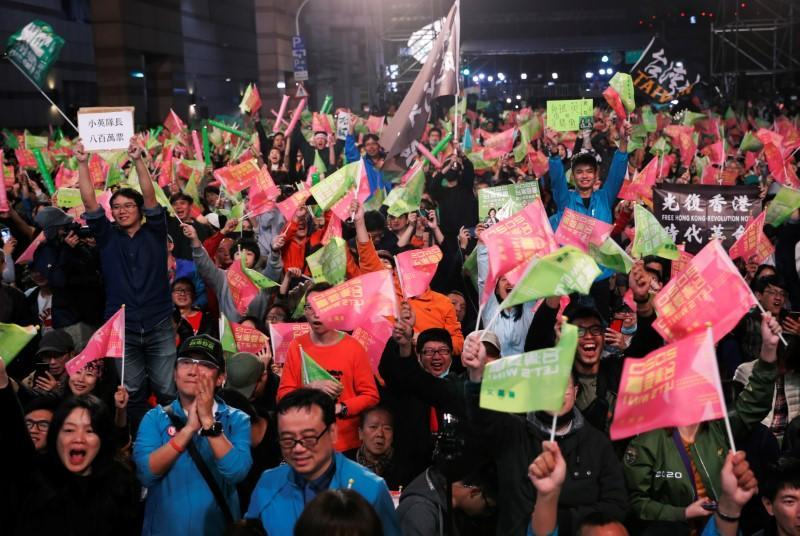 Supporters of Taiwan President Tsai Ing-wen celebrate the preliminary results at a rally outside the Democratic Progressive Party (DPP) headquarters in Taipei