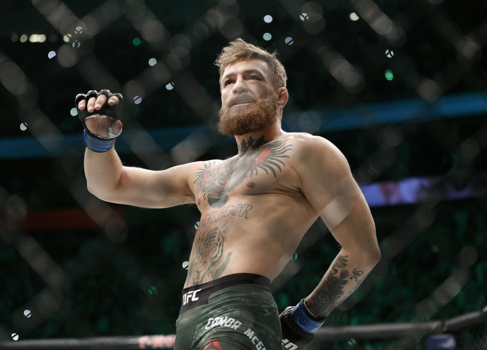 """FILE - In this Oct. 6, 2018, file photo, Conor McGregor walks in the cage before fighting Khabib Nurmagomedov in a lightweight title mixed martial arts bout at UFC 229 in Las Vegas.  Superstar UFC fighter McGregor has announced on social media that he is retiring from mixed martial arts. McGregor's verified Twitter account had a post early Tuesday, March 26, 2019,  that said the former featherweight and lightweight UFC champion was making a """"quick announcement."""" (AP Photo/John Locher, File)"""