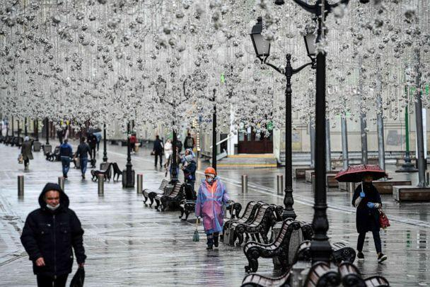 PHOTO: People walk during a light rain shower on a street in downtown Moscow, Russia, on June 1, 2020. (Kirill Kudryavtsev/AFP via Getty Images)