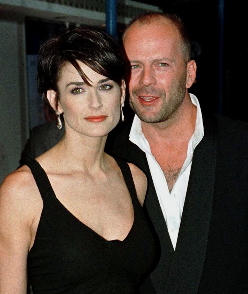"""Film stars Demi Moore and Bruce Willis, shown in a August 6, 1997 file photo at a premiere in Los Angeles, have officially ended their 13-year marriage, according to the television show """"Access Hollywood."""" The syndicated program reported October 25, 2000 that the couple's divorce became official a week ago. BK/RCS"""