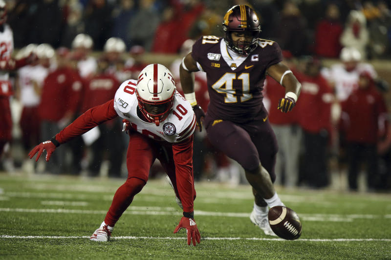 Nebraska wide receiver JD Spielman tries to grab the ball he fumbled against Minnesota linebacker Thomas Barber during the second half of an NCAA college football game Saturday, Oct. 12, 2019, in Minneapolis. (AP Photo/Stacy Bengs)