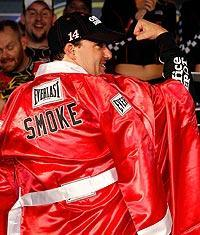 Tony Stewart celebrates like a prize fighter after his fourth victory of the 2011 Chase