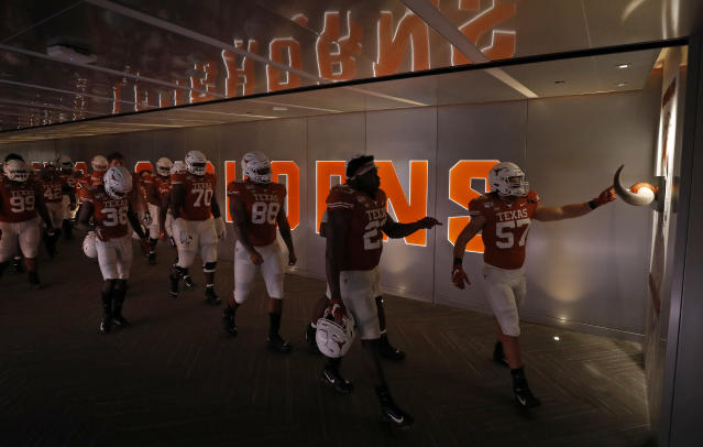 Members of the Texas Longhorns touch the longhorns as they walk to the field after half time during the game against LSU Tigers Saturday Sept. 7, 2019 at Darrell K Royal-Texas Memorial Stadium in Austin, Tx. ( Photo by Edward A. Ornelas )