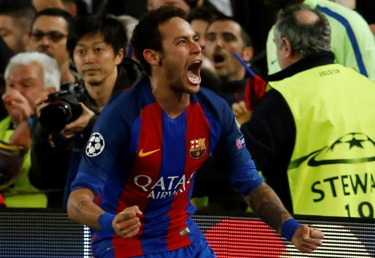 Barcelona's Neymar celebrates at the end of the Champions League match against Paris Saint-Germain at the Nou Camp stadium on March 8, 2017