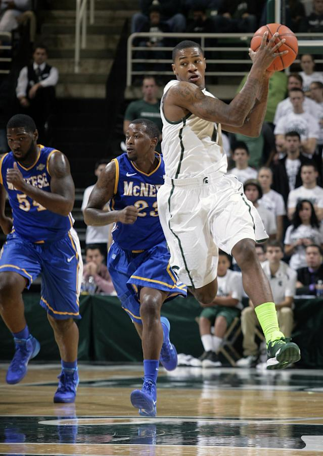 Michigan State's Keith Appling, right, catches a pass in front of McNeese State's Pete Kpan, left, and Brandon Regis (23) during the second half of an NCAA college basketball game, Friday, Nov. 8, 2013, in East Lansing, Mich. (AP Photo/Al Goldis)