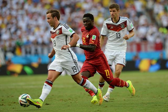 Ghana midfielder Sulley Muntari (C) tracks Germany forward Mario Goetze (L) during a World Cup Group G match at the Castelao Stadium in Fortaleza, northern Brazil on June 21, 2014 (AFP Photo/Carl de Souza)