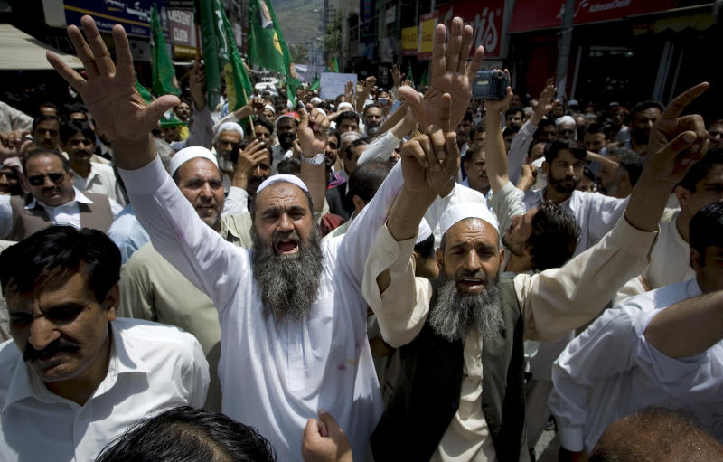 Supporters of a Pakistani opposition group Pakistan Muslim League-N party chant slogan during an anti U.S. rally in Abbottabad, Pakistan on Thursday, May 12, 2011. Pakistan's opposition leader Nawaz Sharif called for the judiciary to investigate the events surrounding bin Laden's death, rather than the army, but it's unclear if his proposal will gain any traction. (AP Photo/Anjum Naveed)