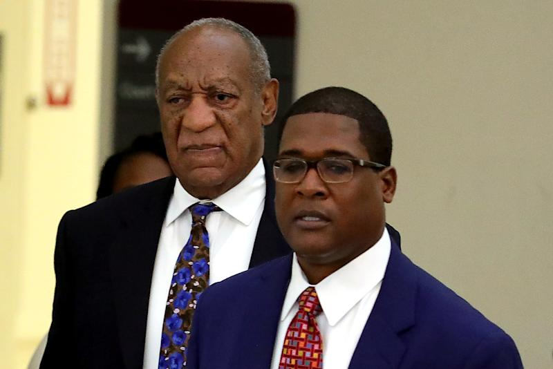 Bill Cosby and publicist Andrew Wyatt at the Montgomery County Courthouse in Norristown, Pennsylvania, on Monday.