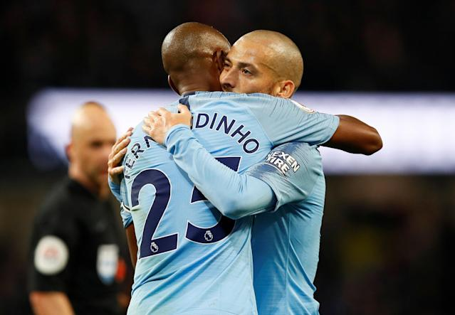 """Soccer Football - Premier League - Manchester City v Manchester United - Etihad Stadium, Manchester, Britain - November 11, 2018 Manchester City's David Silva celebrates with Fernandinho after the match Action Images via Reuters/Jason Cairnduff EDITORIAL USE ONLY. No use with unauthorized audio, video, data, fixture lists, club/league logos or """"live"""" services. Online in-match use limited to 75 images, no video emulation. No use in betting, games or single club/league/player publications. Please contact your account representative for further details."""