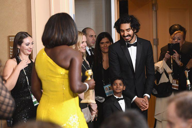 Viola Davis for the win, with Dev Patel looking on. (Photo: Getty Images)