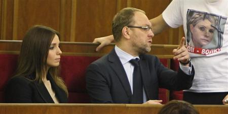 The daughter of jailed opposition leader and former Ukrainian Prime Minister Tymoshenko and Vlasenko attend a session of parliament in Kiev