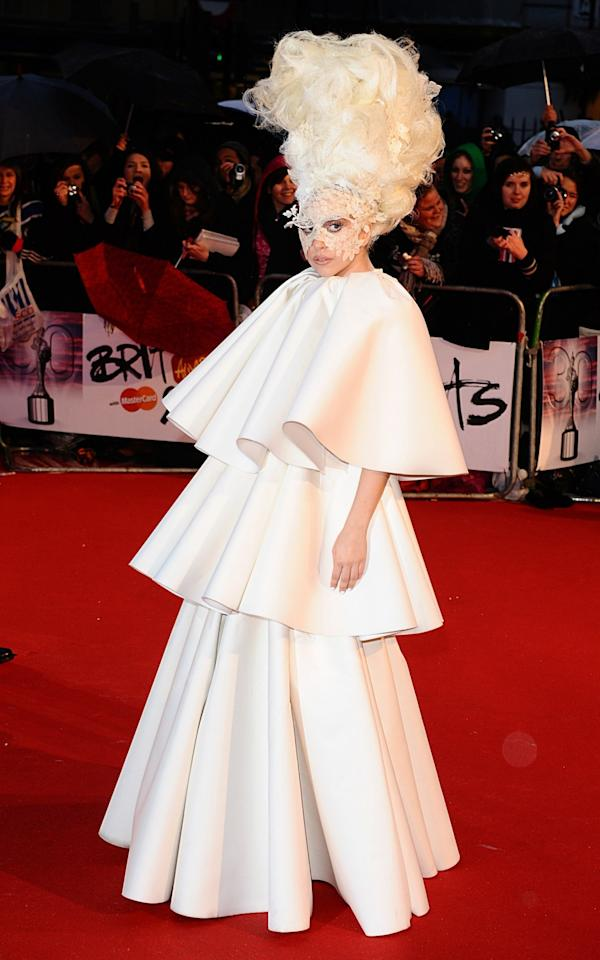 <p>Gaga made quite the entrance at the 2010 Brits in a huge tiered gown by Francesco Scognamiglio. <i>[Photo: PA]</i> </p>