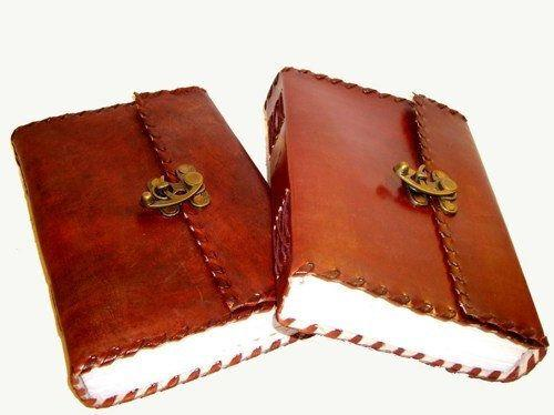 """<a href=""""https://www.etsy.com/ca/listing/211508942/handmade-leather-journal-diary-blank?ref=br_feed_8&br_feed_tlp=gifts"""" target=""""_blank"""">Handmade Leather journal Diary Blank Book, $10.45, available at Etsy </a>"""