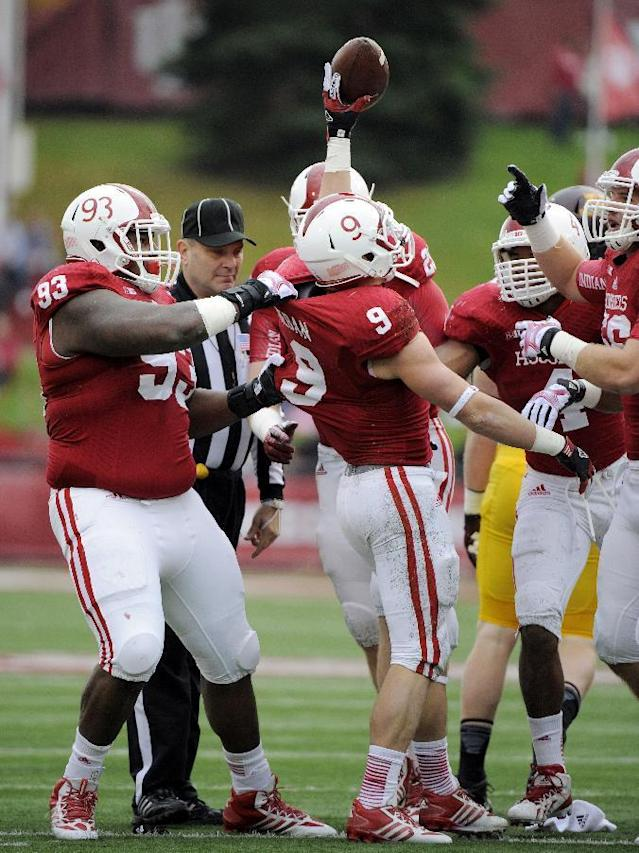Indiana's Greg Heban (9) celebrates after recovering a fumble during the first half of NCAA college football game against Minnesota in Bloomington, Ind., Saturday, Nov. 2, 2013. (AP Photo/Alan Petersime)