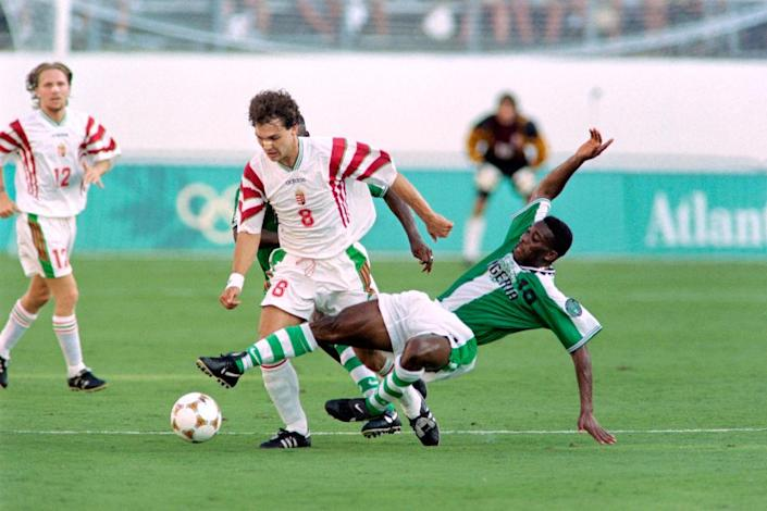"""On July 21, 1996, Hungary's Tamas Sandorduring (C, 8) fights for the ball with Nigeria's Azuka Okocha (10) during the first half of their 1996 Summer Olympic match in Orlando.<span class=""""copyright"""">Pascal George—AFP via Getty Images</span>"""