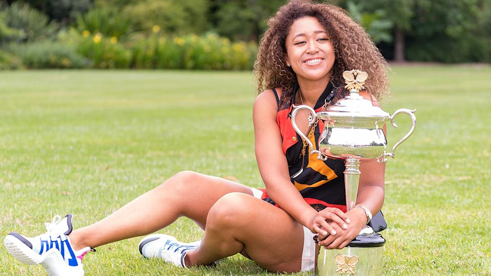 Naomi Osaka, pictured here with the Daphne Akhurst Memorial Trophy after winning the 2021 Australian Open.