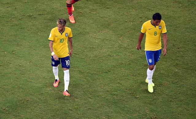 Brazil's Neymar, left, and Paulinho leave the pitch after the group A World Cup soccer match between Brazil and Mexico at the Arena Castelao in Fortaleza, Brazil, Tuesday, June 17, 2014. (AP Photo/Francois Xavier Marit, pool)