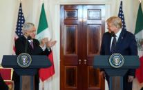 U.S. President Trump and Mexico's President Lopez Obrador make joint statements before dinner at the White House in Washington