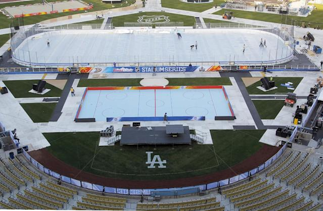 A hockey rink is ready at Dodger Stadium for the upcoming 2014 NHL Stadium Series hockey game in Los Angeles, seen Wednesday, Jan. 22, 2014. The Los Angeles Kings and Anaheim Ducks will play outdoors at Dodger Stadium Saturday, Jan. 25th. (AP Photo/Nick Ut)
