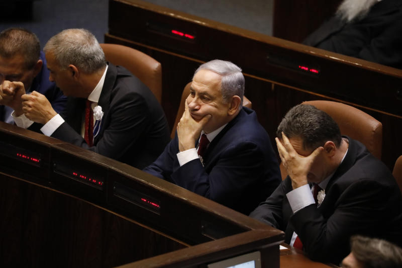 Israeli Prime Minister Benjamin Netanyahu attends the swearing-in of the new Israel's parliament in Jerusalem, Thursday., Oct. 3, 2019. (AP Photo/Ariel Schalit)