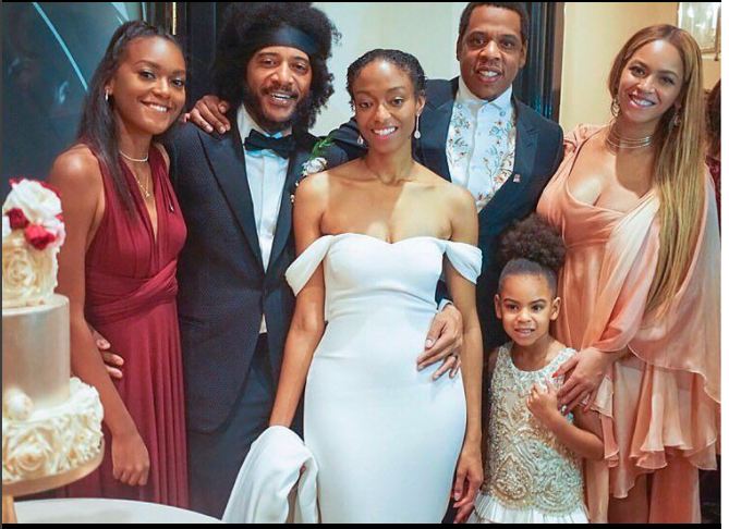 Blue Ivy is pictured at a friend's wedding with her mum Beyonce and her dad Jay Z. Photo: Instagram