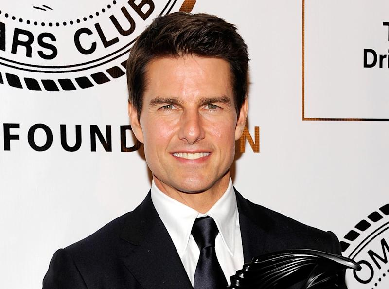 FILE - This June 12, 2012 file photo shows actor Tom Cruise at The Friars Club and Friars Foundation at The Waldorf-Astoria in New York. Authorities say a security guard at Tom Cruise's Beverly Hills, Calif., mansion used a stun gun on a trespasser who turned out to be an intoxicated neighbor who may have mistakenly entered the property. Police say 41-year-old Jason Sullivan was shot with a Taser at about 9:30 p.m. Sunday, Oct. 28, at the home. He was then treated at a hospital and arrested on suspicion of trespassing. Police say neither Cruise nor his family were at the home when a guard saw a man climbing a fence to get onto the grounds.  (Photo by Evan Agostini/Invision/AP, file)