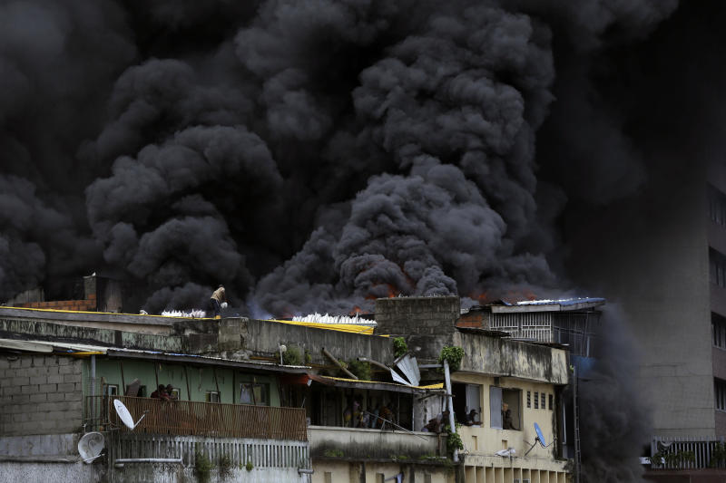 Smoke rises from a fire in downtown Lagos, Nigeria, Tuesday, Nov. 5, 2019. (Photo: Sunday Alamba/AP)