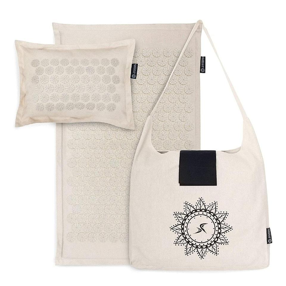 """Acupressure helps relieve muscle tension throughout your body, and you can DIY it at home with pressure mats. Intrigued? <a href=""""https://vm.tiktok.com/ZMRm6apv2/"""" rel=""""nofollow noopener"""" target=""""_blank"""" data-ylk=""""slk:TikTokers love this mat and pillow set"""" class=""""link rapid-noclick-resp"""">TikTokers love this mat and pillow set</a> that allows you to hit different pressure points while relaxing on your back. $60, Amazon. <a href=""""https://www.amazon.com/ProSource-Acupressure-Pillow-Relief-Relaxation/dp/B08FWHPTVK"""" rel=""""nofollow noopener"""" target=""""_blank"""" data-ylk=""""slk:Get it now!"""" class=""""link rapid-noclick-resp"""">Get it now!</a>"""