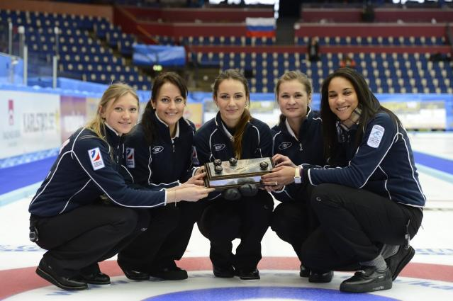 (L to R) Russia's Lyudmila Privivkova, Ekaterina Galkina, Anna Sidorova, Margarita Fomina and Nkeiruka Ezekh pose with their trophy after winning on December 15, 2012 the European Curling Championship final match against Scotland in Karlstad, Sweden. AFP PHOTO / JANERIK HENRIKSSON / SCANPIX /SWEDEN OUTJANERIK HENRIKSSON / SCANPIX/AFP/Getty Images